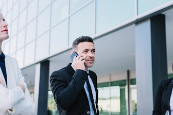 Business person phoning with smartphone