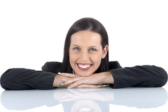 Business woman leaning on a desk