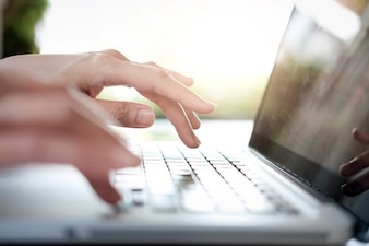 Business woman's hands typing on laptop keyboard