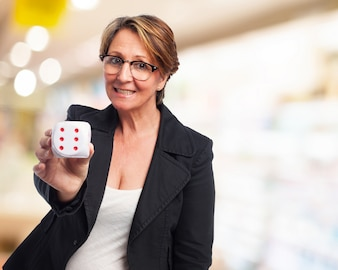 Business woman smiling with a die