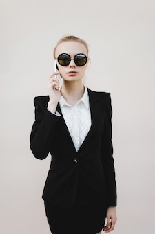 Business woman with black sunglasses