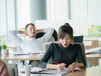 Business woman yawn in office