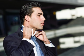 businessman adjusting his shirt collar