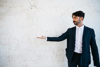 Businessman doing presentation gesture