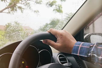 Businessman driving with both hands on steering wheel selective focus. safety driving concept.