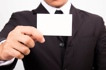 Businessman holding a blank business card