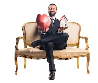 Businessman holding a piggybank