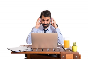 Businessman in his office listening music