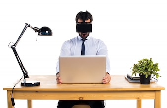 Businessman in his office using VR glasses