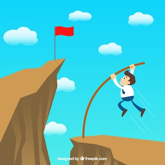 Businessman jumping over the hill
