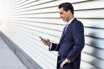 businessman listening to music on his mobile