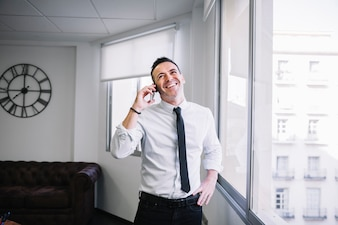 Businessman on phone laughing