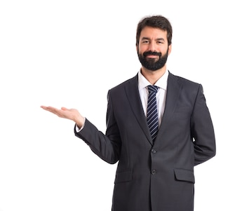 Businessman presenting something over isolated white background