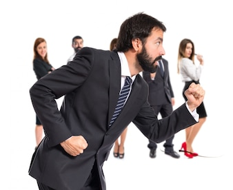 Businessman running fast over white background
