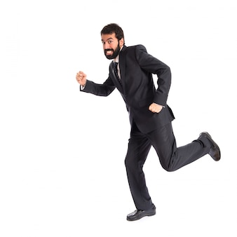 Businessman running fast over white background