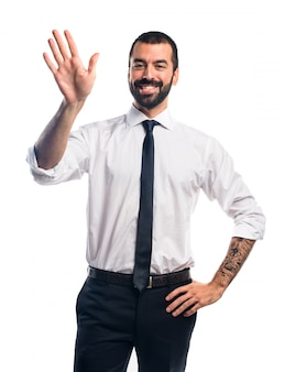 Businessman saluting
