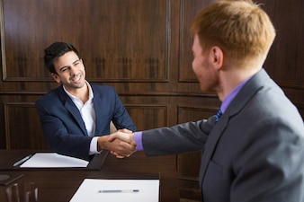 Businessman shaking hands with another man