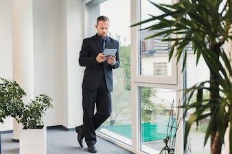 Businessman standing in office with table