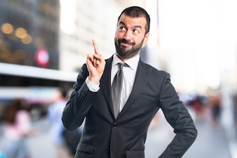 Businessman thinking on unfocused background