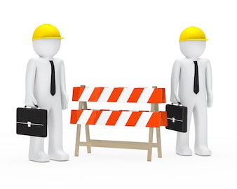 Businessmen next to a barrier