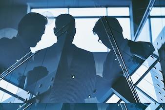 Businessmen reflection