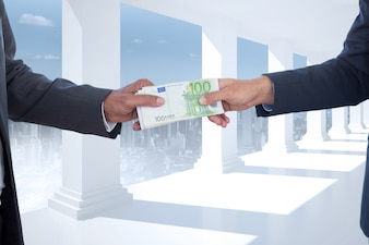 Businessmen with bills on a background of white columns