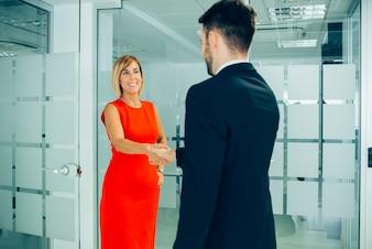 Businesswoman giving a firm handshake