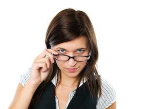 Businesswoman playing with her black glasses