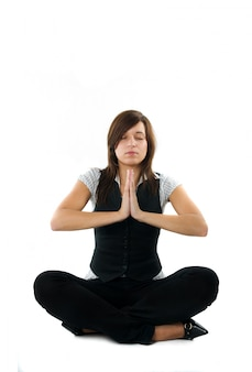 Businesswoman practicing yoga before starting to work