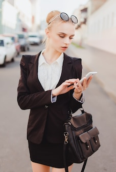 Businesswoman writing on a phone