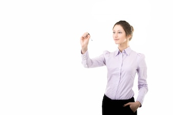 Businesswoman writing something in the air with pen