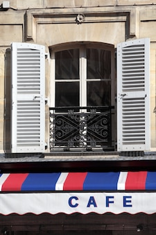 Cafe canopy and window in paris