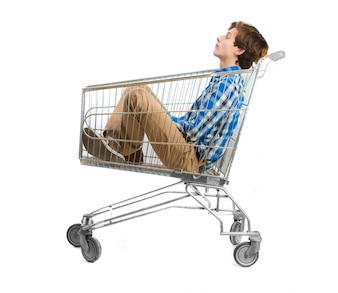 Calm teenager sitting on a cart