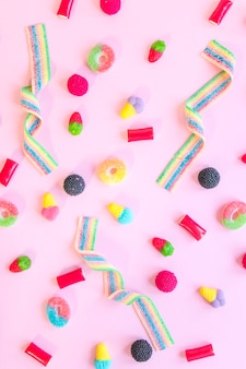 Candies scattered on pink table