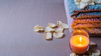 Candle and towels in spa