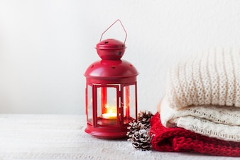 Candle in a lamp with towels next to it