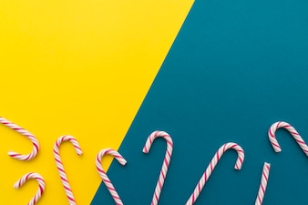 Candy canes on yellow and blue background