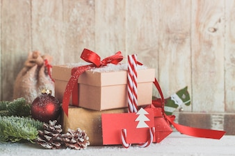 Candy canes with red envelopes and gifts