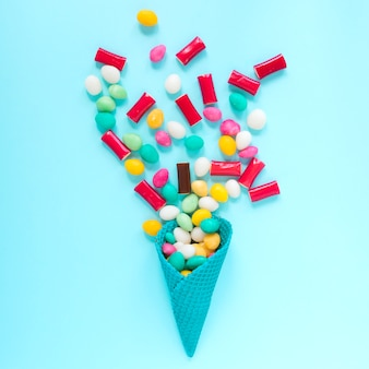 Candy stones in blue cone