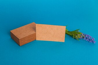 Cardboard business card mockup with flower