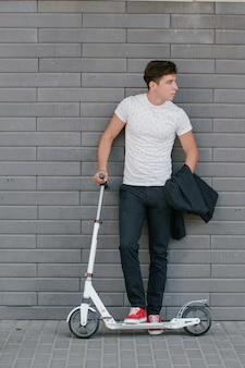 Casual boy with a scooter