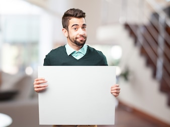 Casual man holding a blank sign