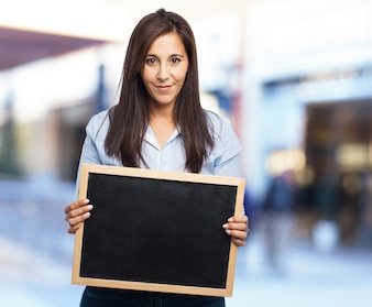 Casual woman with a blackboard in the hands