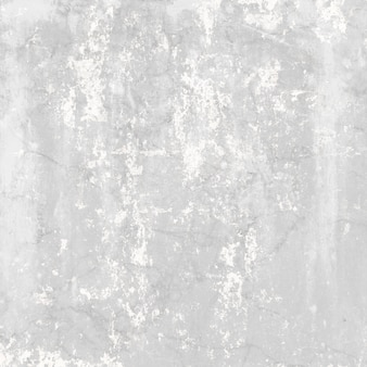 Cement wall with white areas and cracks