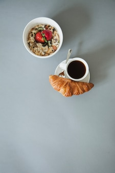 Cereal and coffee with croissant