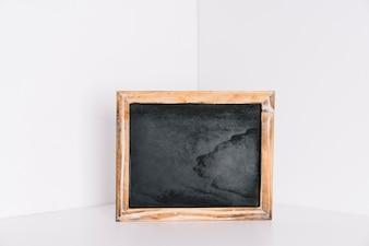 Chalkboard in corner of room