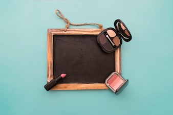 Chalkboard with makeup and lipstick