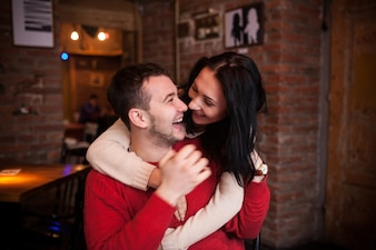 Charming couple embracing and laughing loud