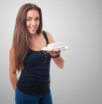 Charming female offering cake