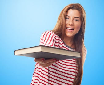 Charming girl with book in hand